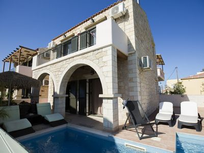 Photo for This 2-bedroom villa for up to 5 guests is located in Agia Marina (Crete) and has a private swimming