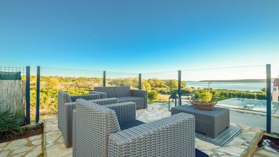 Photo for The villa with a sea view from each bedroom is just 100 meters from the sea, the pool and the garden