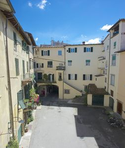 Photo for Family-friendly flat in a tiny square in the center of the walled town of Lucca
