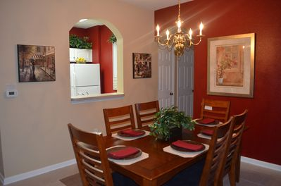 Dining area for 6 with kitchen pass through. Room for high chair near table.