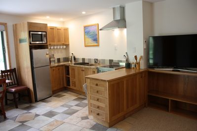 Solid wood with granite counter top. Full size stove, fridge and microwave.