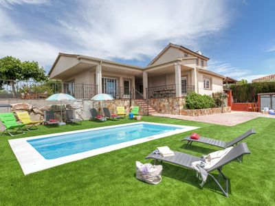 Photo for This 6-bedroom villa for up to 10 guests is located in Vidreres and has a private swimming pool and