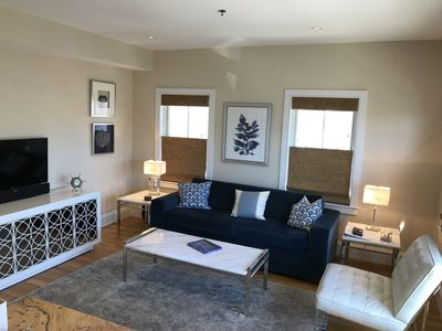 Photo for Chic and modern 1-bedroom, town center, water view, parking