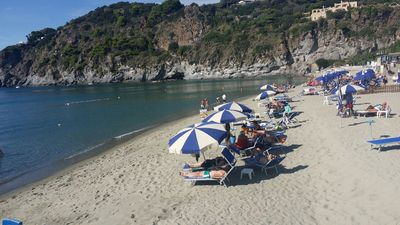 Photo for THE MERIDIANA APARTMENT ON THE SEA WITH PRIVATE BEACH SDRAIO AND UMBRELLA