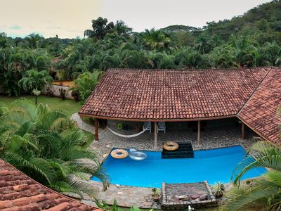 Photo for Private Pool & Yard~Secluded Getaway~ Minutes to the Beach