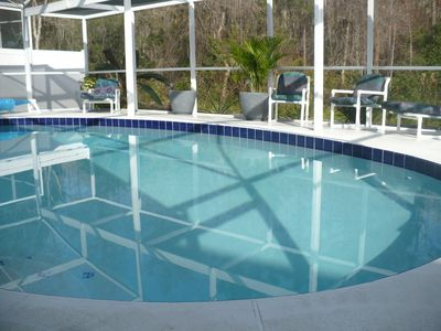 Outdoor seating for 8 around the pool
