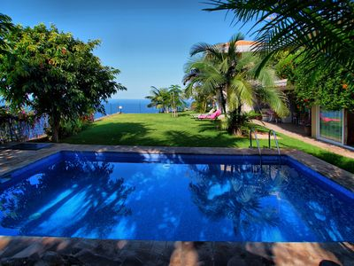 Photo for Frontline Oasis Villa with private heated pool, Sea, Teide and coastline views