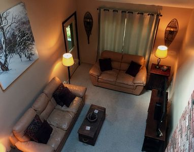 Living room with leather couches (view from loft)