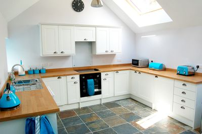 Large fitted kitchen with dishwasher and washing machine