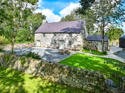 Photo for Penarth Fawr is a beautifully converted, Grade 2 cottage in a tranquil and historic location. Nestle