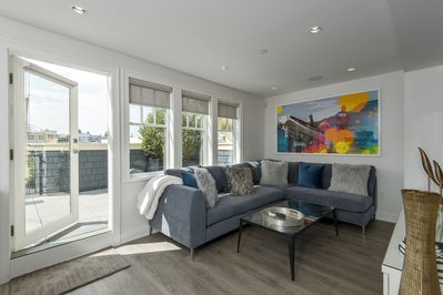 Living Room - Custom Art and connected to an outdoor Terrace