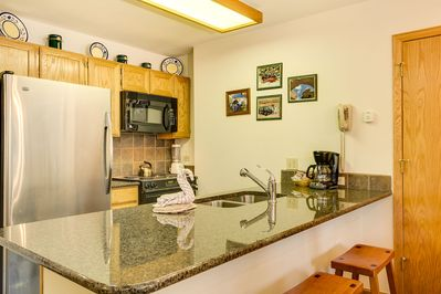 Our modern, well-equipped kitchen with seating for 3 at the breakfast bar