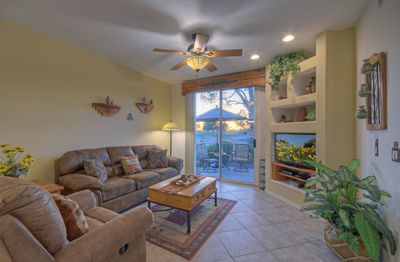 Great room with recliner is arranged to view TV, plan exciting excursions or enjoy outdoor view