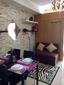 Photo for Cozy 1BR condo at Shell Residences near Mall of Asia