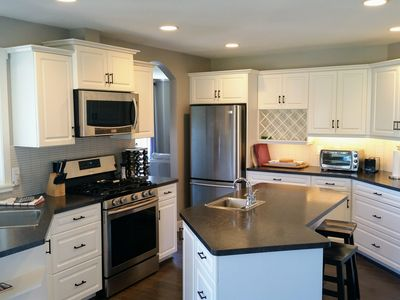 Well equipped kitchen, gas range, 2 sinks & walk out to balcony