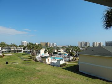 This newly updated 2/2 overlooks the pool, golf course and Destin Skyline!