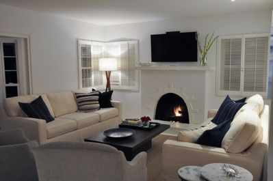 Spacious living room with two large couches and comfortable sitting chairs.