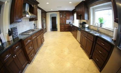 Gourmet Kitchen w/Granite Counter and Stainless Steel Appliances and Travertine Floors