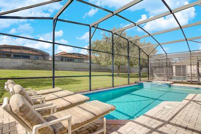 Heated outdoor pool with removable child safety fence
