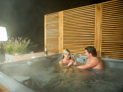 Photo for Extra luxury 4-person Wellnessfarmhouse in the holiday park Hof van Saksen - on the water/recreation lake