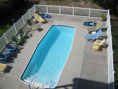 Large pool with lots of seating for family gatherings
