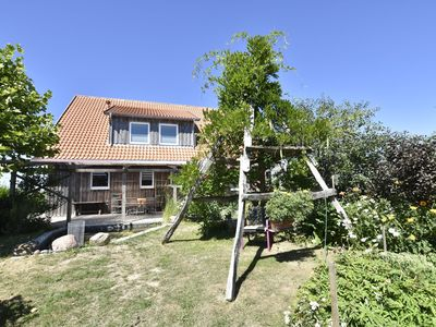 Photo for Apartment in outskirts / garden / terrace / beach