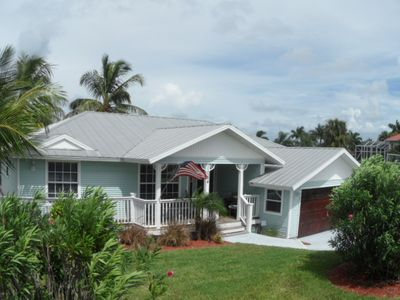 Charming Key West Style 3/2 Home, waterfront with pool and screen enclosure
