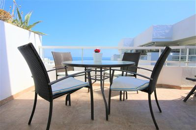 Lovely extra dining area on the terrace with sea views