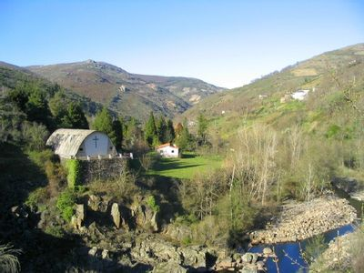 Photo for Immense Galician rural house, facing the river, with fireplace and large gardens
