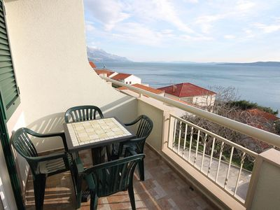 Photo for Two bedroom apartment with terrace and sea view Pisak, Omiš (A-4815-b)