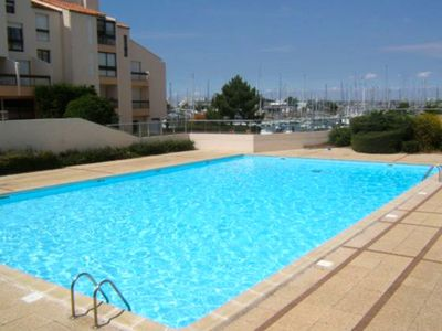 Photo for Studio with swimming pool on the port of Minimes in La Rochelle