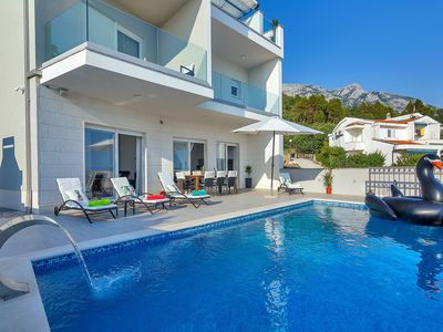 Photo for NEW! Holiday house with heated pool, two terraces with sea view, four bedrooms