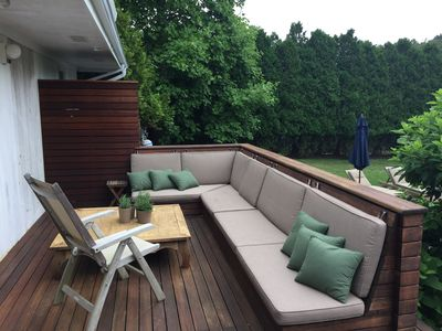Customized seating on wood deck for casual get-togethers
