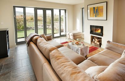 Ground floor: Open plan sitting room and kitchen with amazing views
