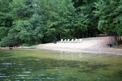 Sandy clear water beach with grill, hot tub and picnic area.