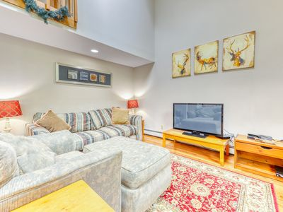 Photo for NEW LISTING! Spacious townhome with a deck, fireplace, and a shared pool!