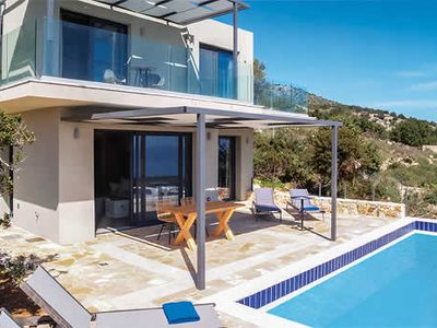Photo for Great sea views, above the coast, close to beach, shops and restaurants. Modern, peaceful villa, with charming, comfortable interiors, free pool towels, hairdryers, Wi-Fi and air conditioning.