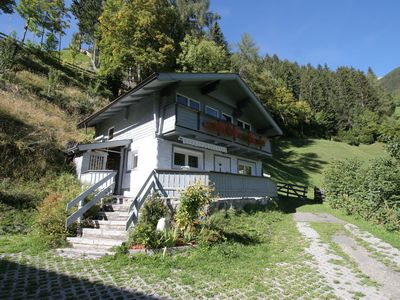 Photo for A former farmhouse with a wooden decor in the mountains