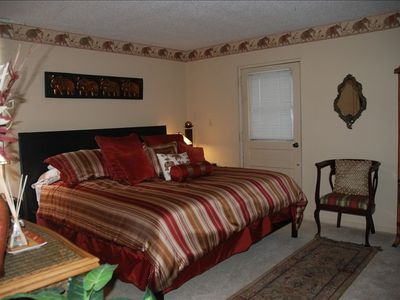 Bedroom w comfortable king size bed. Walk-in closet.