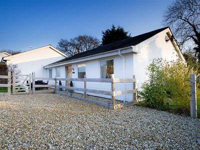 Photo for Well-equipped with lots of extras including a games console, this modern bungalow offers a spacious