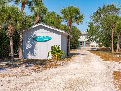 Photo for The bayfront Aurora Bay House on Manasota Key has access to the gulf and great docking.