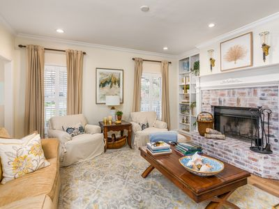 Photo for Classic Southern home with double front porches, close to golf and the beach