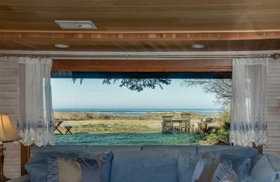 Photo for Oceanfront 1 story. 'Beachfront Hideaway' - treed setting, ocean in the back yd!