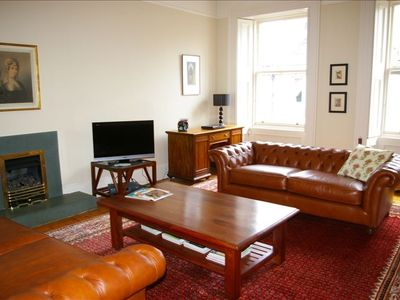 Relax in the stylish lounge with comfy leather sofas and living flame gas fire