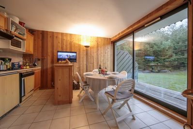 Dining area and large sliding doors to the terrace and garden