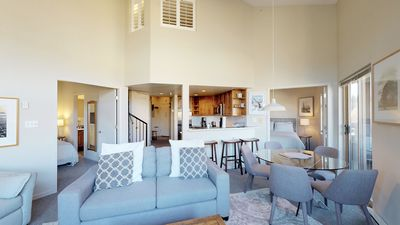 Living room features a Queen sized sofa bed and dining area that comfortably seats 5 guests