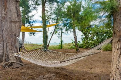 Hammock big enough for two. The Gulf breeze will put you to sleep!