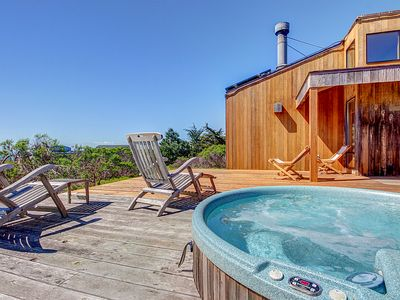 Photo for Contemporary coastal home with private hot tub, shared pool & ocean views!