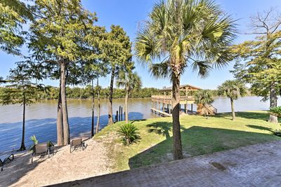 Enjoy the private beach and dock that boasts an upper level deck!