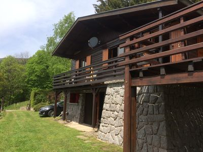 Photo for Large mountain chalet in the heart of nature, sauna, panoramic view, spring water
